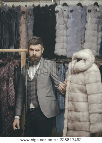 Purchase, Shopping, Business, Moneybags. Purchase Of Man Buy Fur Coat In Shop