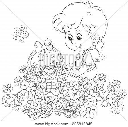 Easter Egg Hunt In Flowers. Little Girl With A Decorated Basket Collecting Painted Eggs Among Daisie