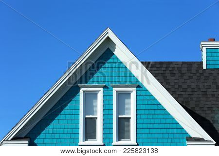 Detail of a turquoise rooftop in Iles de la Madeleine in Canada