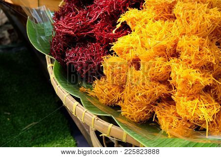 Piles Of Crispy Sweetened Fried Taro And Potato In Purple And Yellow Color, Sliced In Small Pieces,