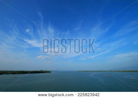 Wide Angle View Of Skyline At Estuary From A River To Gulf Of Thailand And The Bright Beautiful Clou