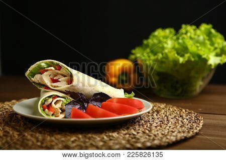 Shaurma Without Sauce With Chicken, Pepper, Lettuce. Low-calorie Roll From Pita Bread, Next To Purpl