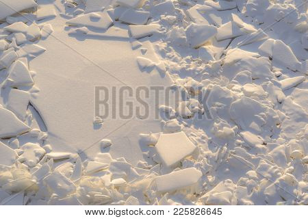 The Textured Splinters And Pieces Of Broken Ice Of Frozen Water And Snow In The Nature For An Abstra