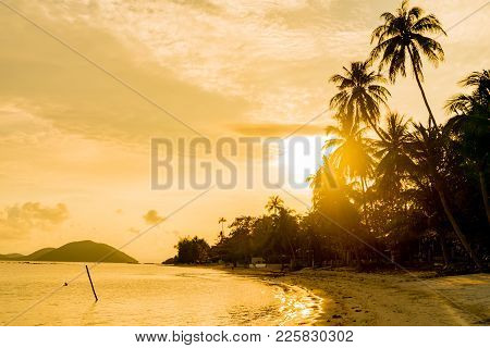 Golden Hues Of Sunrise Along Ko Samui Beach, Thailand.