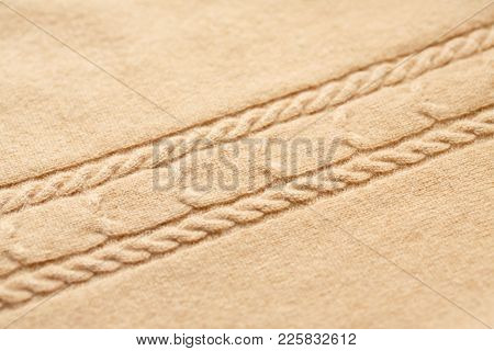 Background Texture Of Brown Pattern Knitted Fabric Made Of Cotton Or Wool Closeup