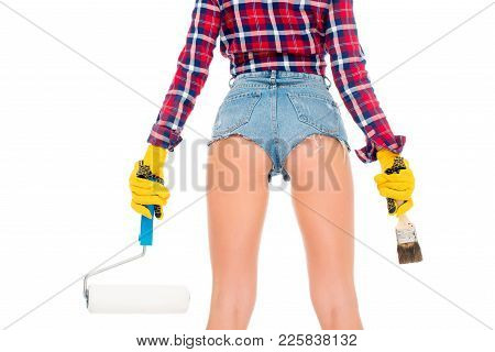 Back View Of Sexy Girl In Gloves Holding Painting Roller And Brash, Isolated On White