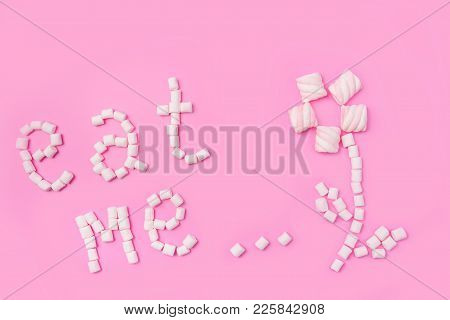 Marshmallows On Pink Background With Sign In English Eat Me. Flat Lay Or Top View. Background Or Tex