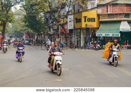 Hanoi, Vietnam - December 05, 2016: Car And Motorbike Traffic In The Old Quarter In Hanoi.