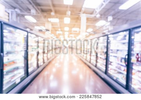 Blurred Frozen And Prepared Food Aisle At Retail Store In America