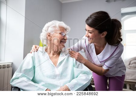 Satisfied And Happy Senior Woman Patient With Nurse