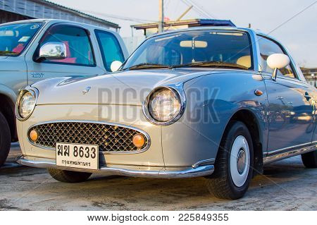 Thailand - January , 2017: An Emerald Green Vintage Nissan Figaro In Front Of A Launderette. The Fig