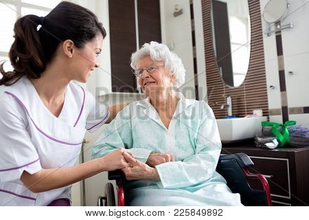 Senior Old Woman With Nurse