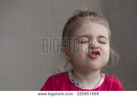 Portrait Of Emotional Little Girl. Happy Blonde Child. Grimacing Child. Swearing, Screaming Little G