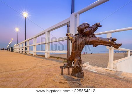 GDANSK, POLAND - FEBRUARY 2, 2018: Little lion statue on the Baltic sea pier in Brzezno, Poland. Lion is symbol od Gdansk city situated by the Baltic Sea.