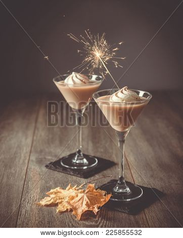 Two glasses of Irish cream liqueur with sparkler for a celebration