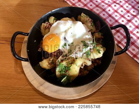 Tiroler Groestl, A Typical Tyrolean Speciality With Fried Potatoes , Bacon, Meat And Fried Egg Serve