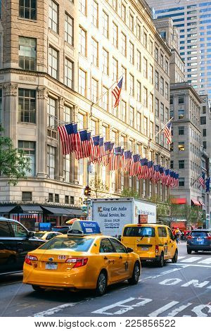 New York City, Usa - June 21, 2016: Yellow City Cabs In The Streets Of Manhattan With American Flags
