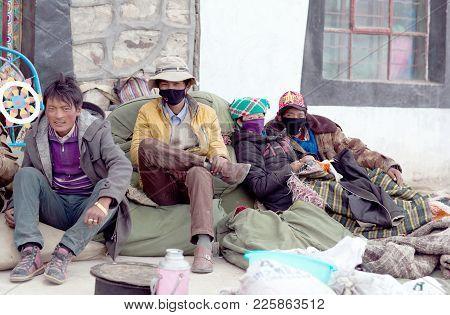 TIBET, CHINA - MAY 4, 2013: Tibetan men working in buddhist temple in Ngari prefecture