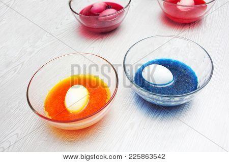 Baby Girl Preparing Easter Eggs. Top View