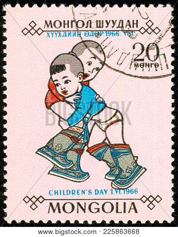 Ukraine - Around 2018. The Postage Stamp Printed In Mongolia Shows Playing Children. The Mongolian T