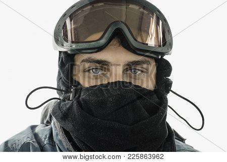 A Portrait Of A Young Handsome Man (twenty Five - Thirty Five Years Old) In A Black Fleece Ski Mask
