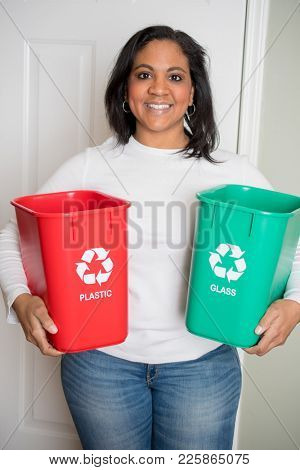 Woman taking out her recycling containers at home
