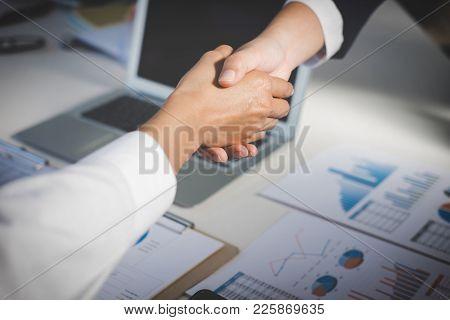 Teamwork Process, Image Of Business Team Greeting Handshake. Successful Business People Handshaking
