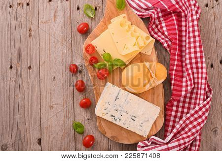 Various Type Of Italian Cheeses On Cuttingboard.