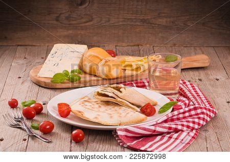 Cascione Italian Flatbread With Cheeses On Cuttingboard.