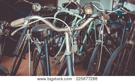 Many Old Antique Vintage Bicycle Show In Bicycle Shop With Vintage Style. Detail Of A Vintage Bicycl