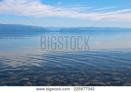 Landscape With The Image Lake Baikal And The Mountains In Buryatia. Warm Sunny Day In Siberia. Cryst