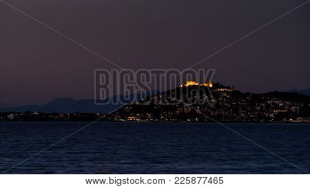 Night Scene Of Astros Town With Old Ruined Castle Of Zafeiropouloi, Greece Peloponnese Arcadia. Trav