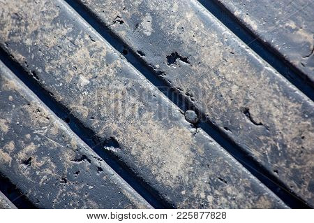 Close-up Of The Tread Of A Used Tire