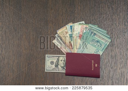 Foreign Passport With Money Of South-east Asia And American Hundred Dollar Bill. Currency Of Hong Ko