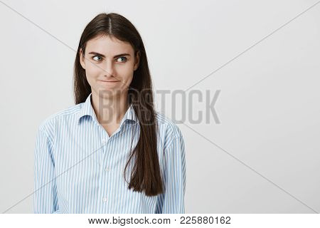 Portrait Of Funny And Cute Caucasian Female With Insidious Smile Thinking Something Nasty Or Evil Wh