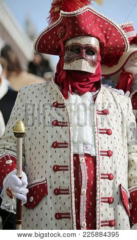 Venice, Italy - February 5, 2018: Person In Costume With Carnival Mask And The Ancient Venetian Dres