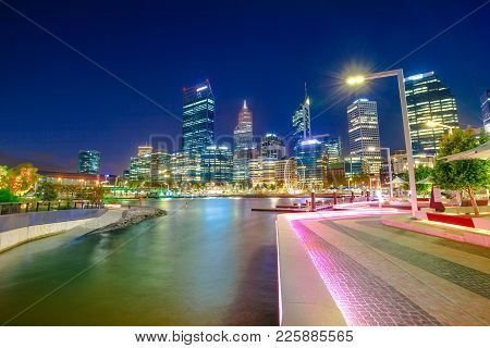 Walkway With Night Lighting At Elizabeth Quay Marina And Esplanade With Skyscrapers On Swan River. P