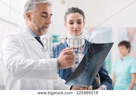 Doctor Examining A Young Female Patient's X-ray