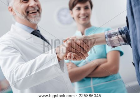 Medical Staff Welcoming A Patient