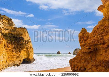 Rocky Cliffs Of Praia Dona Ana At Lagos, Portugal