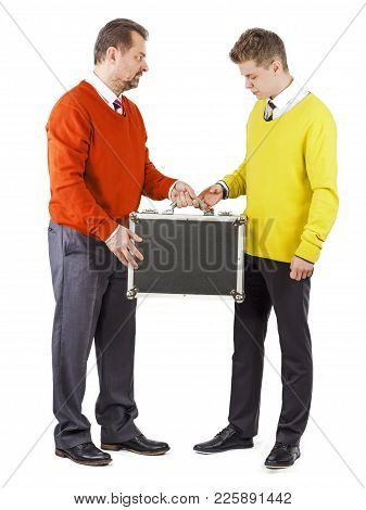 Business Transfer Deal. Handover Of A Suitcase In The Hands Of Partner.