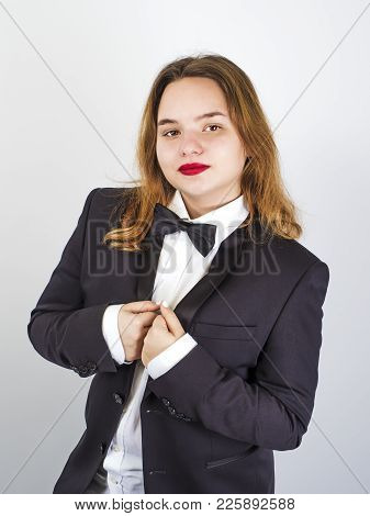 Well-dressed And Elegant Chubby Brown-haired Teenager. Light Background.