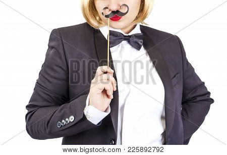 Elegant Woman In A Tailcoat With A Black Paper Mustache On A Stick On A White Background, Part Of A