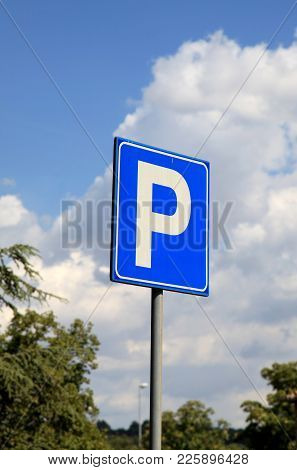 Parking Sign - Blue Road Sign With Letter P Against A Blue Sky.