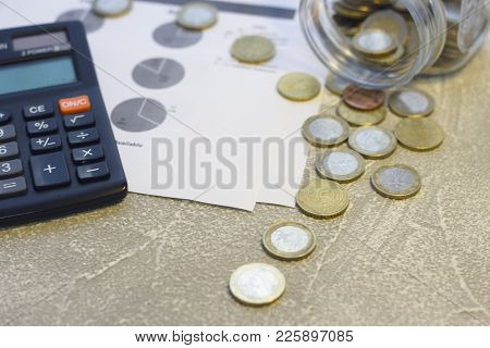 Euro Coins And Calculator. Euro Money. Euro Currency. Coins Stacked On Each Other In Different Posit