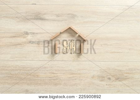 Top View Of The Shape Of A Residential House Made Of Building Wooden Blocks For A Family With Three