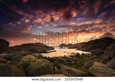 Amazing View Sunset Over The Nordic Rocks On The Most Southern Point Of Norway In Lindesnes, South C