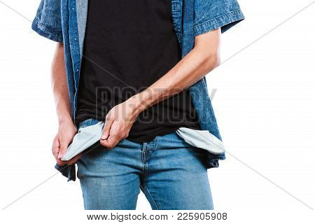 Financial Difficulties, Bad Economy, No Money Concept. Young Man Student Boy Showing Empty Pockets,