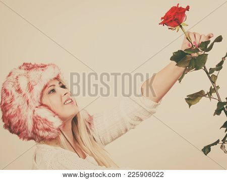 Accessories And Clothes For Cold Days, Fashion, Romantic Gestures Concept. Woman In Winter Furry Hat