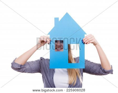Dream About Stabilization And Family. Blonde Girl Holding Blue Paper House Model Cutout. New Flat Ap